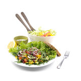 Salad, dressing, a salad bowl and bread Royalty Free Stock Image