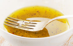 Salad dressing in a white bowl. Royalty Free Stock Images