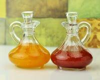 Salad dressings. Italian  and raspberry vinaigrette salad dressings in glass bottles Stock Images