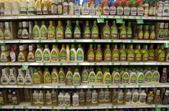 Salad dressings in grocery store Stock Photos