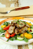 Salad with duck breast, cherry tomatoes Royalty Free Stock Image