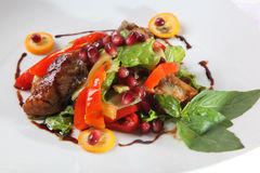 Salad with duck breast and pomegranate Royalty Free Stock Photo