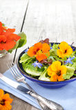Salad with edible flowers nasturtium, borage. Stock Photo