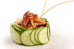 Salad with eel and cucumber. Isolated on white Royalty Free Stock Image