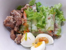 Salad. With egg and grill pork on white bowl Stock Photos