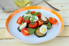 Salad with eggplant, tomato and eggs Royalty Free Stock Photography