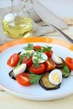Salad with eggplant, tomato and eggs Stock Images
