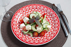 Salad, ethnic dish, plate and a cup Stock Photo