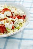 Salad with feta cheese, tomato and corn Stock Photo