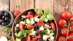 Salad with feta. Tomato, olive and basil royalty free stock image