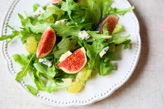 Salad with figs, cheese and grapes, top view Stock Images