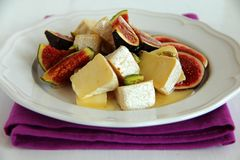 Salad with figs and honey. Royalty Free Stock Photo