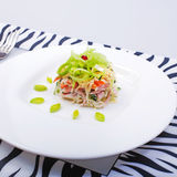 Salad with fish and crabs on white plate Royalty Free Stock Image