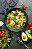Salad with fish. Fresh vegetable salad with salmon fish fillet. Fish salad with salmon fillet and fresh vegetables. On plate stock images