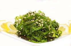 Salad and fish roe stock photos