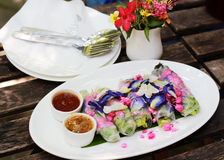 Salad flower roll. With sauce.Lettuce, Butterfly pea and Mexican Creeper Royalty Free Stock Photo