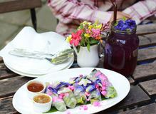 Salad flower roll. With sauce.Lettuce, Butterfly pea and Mexican Creeper Stock Images