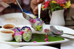 Salad flower roll. With sauce.Lettuce, Butterfly pea and Mexican Creeper Stock Photos