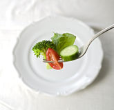 Salad on fork Royalty Free Stock Photos