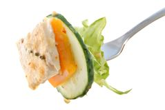 Salad on Fork with Chicken Stock Photo