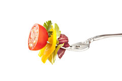 Salad Fork with Tomato Bell Pepper and Lettuce royalty free stock photos