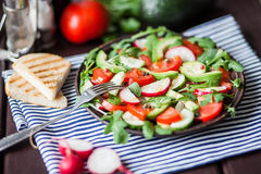 Salad with fresh avocado,tomato,cucumber,radish Royalty Free Stock Photo