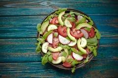 Salad with fresh avocado,tomato,cucumber,radish Royalty Free Stock Photography