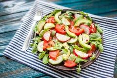Salad with fresh avocado,tomato,cucumber,radish Stock Image