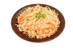 Salad of fresh cabbage and carrots in a clay bowl on a white background is insulated Stock Photos