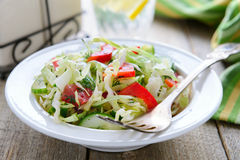 Salad from fresh cabbage, cucumbers and cherry tomatoes Stock Photos