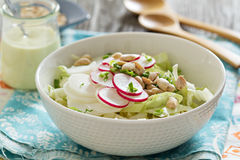 Salad with fresh cabbage, radishes. Peanuts and green onion Stock Photo