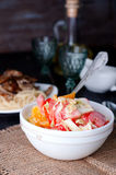 Salad with fresh cabbage. Tomato, cucumber and herbs on the plate on a table Stock Images