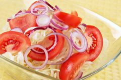 Salad from fresh cabbage, tomatoes and onions Royalty Free Stock Photo