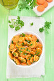 Salad from fresh carrots and parsley Royalty Free Stock Photo