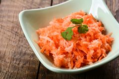 Salad from fresh carrots and radish Royalty Free Stock Image