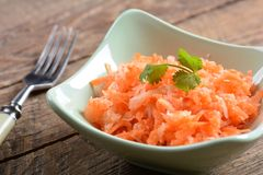 Salad from fresh carrots and radish Stock Photo