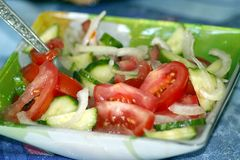Salad from fresh cucumber tomato and onion Royalty Free Stock Images