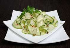 Salad from fresh cucumbers with garlic, dill, spices Royalty Free Stock Images