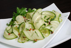 Salad from fresh cucumbers with garlic, dill, spices Royalty Free Stock Photography