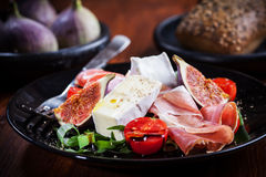 Salad with fresh figs and prosciutto Royalty Free Stock Image