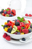 Salad of fresh fruit and berries in a white bowl Royalty Free Stock Photography
