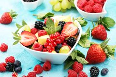 Salad with fresh fruits and berries. healthy spring fruit salad.  Stock Photos