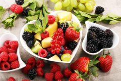 Salad with fresh fruits and berries. healthy spring fruit salad.  Royalty Free Stock Image