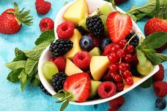 Salad with fresh fruits and berries. healthy spring fruit salad royalty free stock photography