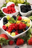 Salad with fresh fruits and berries. healthy spring fruit salad.  Stock Photography