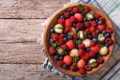 Salad of fresh fruits and berries. horizontal top view Stock Photography