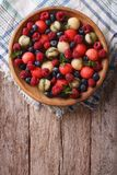 Salad of fresh fruits and berries. vertical top view Stock Photography