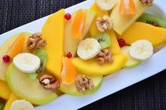 Salad of fresh fruits Stock Photos
