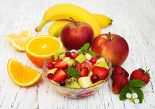 Salad with fresh fruits. On a old wooden background Royalty Free Stock Image