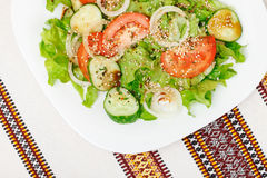 Salad of fresh greens  with soy sauce, dry spices and sesame Stock Photography